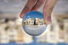 Glass ball. Izmir, Turkey - August 17, 2015: Glass ball and the city. Izmir Alsancak Konak royalty free stock photography
