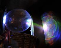 Glass ball with light prism effect. Light shining through a glass ball creating colorful prism display Stock Photos