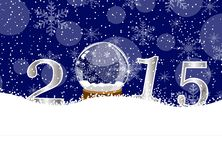 Glass ball and numbers 2015 on to snow Stock Photo