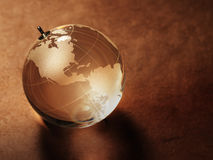Glass ball with a picture of a world map on vintage paper Stock Photography