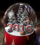 Glass ball. With snow, Christmas trees, Christmas decorations and inscriptions 2016 Stock Images