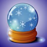 Glass ball with snowflakes Stock Images