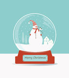 Glass ball with snowman and birds. Royalty Free Stock Photography