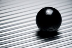 Glass ball view. Glass ball on a metallic table royalty free stock photos