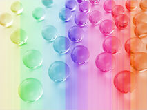 Glass balls. Sprinkled glass balls with a colored background Stock Photo