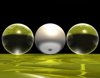 Glass balls. Illustration of three balls, two of glass and another one of burnished metal Royalty Free Stock Images