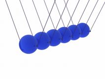 Glass balls. Time kinetic pendulums, and white background Royalty Free Stock Photos