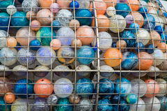 Glass Balls in Cage Stock Photo