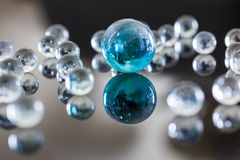 Glass balls. On glossy background Royalty Free Stock Photo