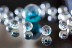 Glass balls. On glossy background Royalty Free Stock Image