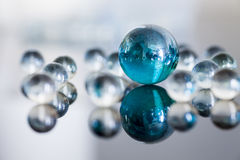Glass balls. On glossy background Stock Image