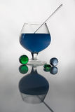 Glass balls and goblet. Still life with glass balls and goblet with blue curacao Royalty Free Stock Photo