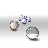 Glass balls. On grey surface Royalty Free Stock Photography