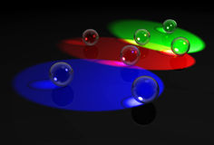 Glass balls in RGB lights Royalty Free Stock Image