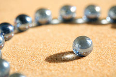 Glass Balls On Sand Royalty Free Stock Photo