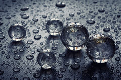 Glass balls, water droplets Stock Photography
