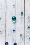 Glass balls on a white vintage Wood Texture Background. Stock Photography