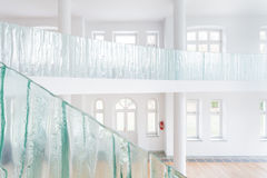 Glass balustrade in spacious house Royalty Free Stock Images