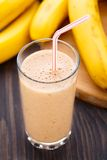 Glass of banana smoothie Stock Photos