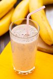 Glass of banana smoothie Stock Photo