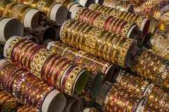 Glass bangles, Hyderabad. Stacks of traditional glass bangles for sall on a stall in Hyderabad, India.  The city is famous for producing jewellery Royalty Free Stock Images
