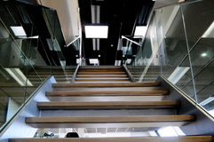 Glass banister and stairs. Tempered glass banister and stairs inside modern office building Stock Photo