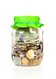Glass bank for tips with money Stock Photo