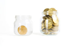 Glass bank for tips with money isolated on white. Stock Photography