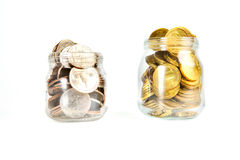 Glass bank for tips with money isolated on white. Royalty Free Stock Photography