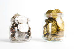 Glass bank for tips with money isolated on white. Stock Photo