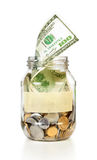 Glass bank for tips with money and put dollars Stock Photos