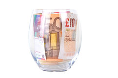Glass with banknotes Royalty Free Stock Photo