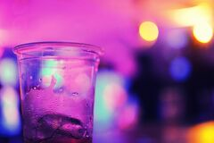 Glass on bar in purple light Royalty Free Stock Photography