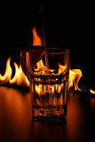 Glass on bar rack in fire Royalty Free Stock Photography