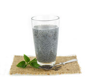 Glass of basil seeds and raw seed against  white Royalty Free Stock Photo