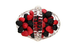 Glass basket full of raspberries and blackberries. Glass basket full of fresh raspberries and blackberries, top view Stock Photography