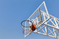 Glass basketball board on blue sky background Royalty Free Stock Photos