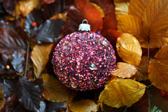 Glass baubles. Traditional Christmas glass baubles on colorful leaves Stock Images