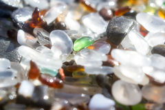 Glass beach background. Close up of the glass pebbles that cover this beach in Fort Bragg using a on camera star filter for a soft dreamy effect Stock Image