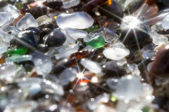 Glass beach background. Close up of the glass pebbles that cover this beach in Fort Bragg using a on camera star filter for a soft dreamy effect Royalty Free Stock Photos