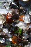 Glass beach background. Close up of the glass pebbles that cover this beach in Fort Bragg using a on camera star filter for a soft dreamy effect Stock Photo
