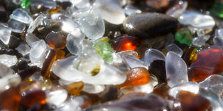 Glass beach background. Close up of the glass pebbles that cover this beach in Fort Bragg using a on camera star filter for a soft dreamy effect Royalty Free Stock Image