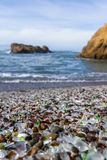Glass Beach, Fort Bragg California. Colorful glass pebbles blanket this beach in Fort Bragg, California, photo taken mid day to get bright color in the rocks and Stock Images