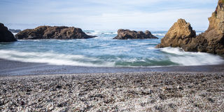 Glass Beach, Fort Bragg California. Colorful glass pebbles blanket this beach in Fort Bragg, California. Photo taken with a slow shutter speed to show motion in Royalty Free Stock Photos