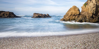 Glass Beach, Fort Bragg California. Colorful glass pebbles blanket this beach in Fort Bragg, California. Photo taken with a slow shutter speed to show motion in Stock Photo