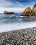 Glass Beach, Fort Bragg California. Colorful glass pebbles blanket this beach in Fort Bragg, California. Photo taken with a slow shutter speed to show motion in Royalty Free Stock Photography