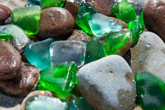 Glass beach. Natural texture with polished sea glass, stones and sand. baltic sea. Close up Stock Images