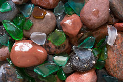 Glass beach. Natural texture with polished sea glass, stones and sand. baltic sea. Top view Royalty Free Stock Image