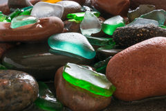 Glass beach. Natural texture with polished sea glass, stones and sand. balticsea Stock Photos