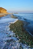 Glass beach in Steklyannaya Bay near Vladivostok. Russia, Primorsky Krai, winter in evening royalty free stock photo